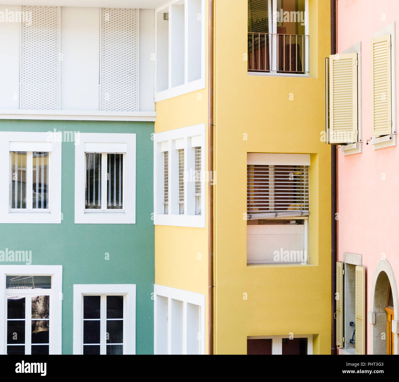 Bright, vivid, three color building of Institut Ongles et Beauté at Nyon, Switzerland; with abundance of windows. - Stock Image