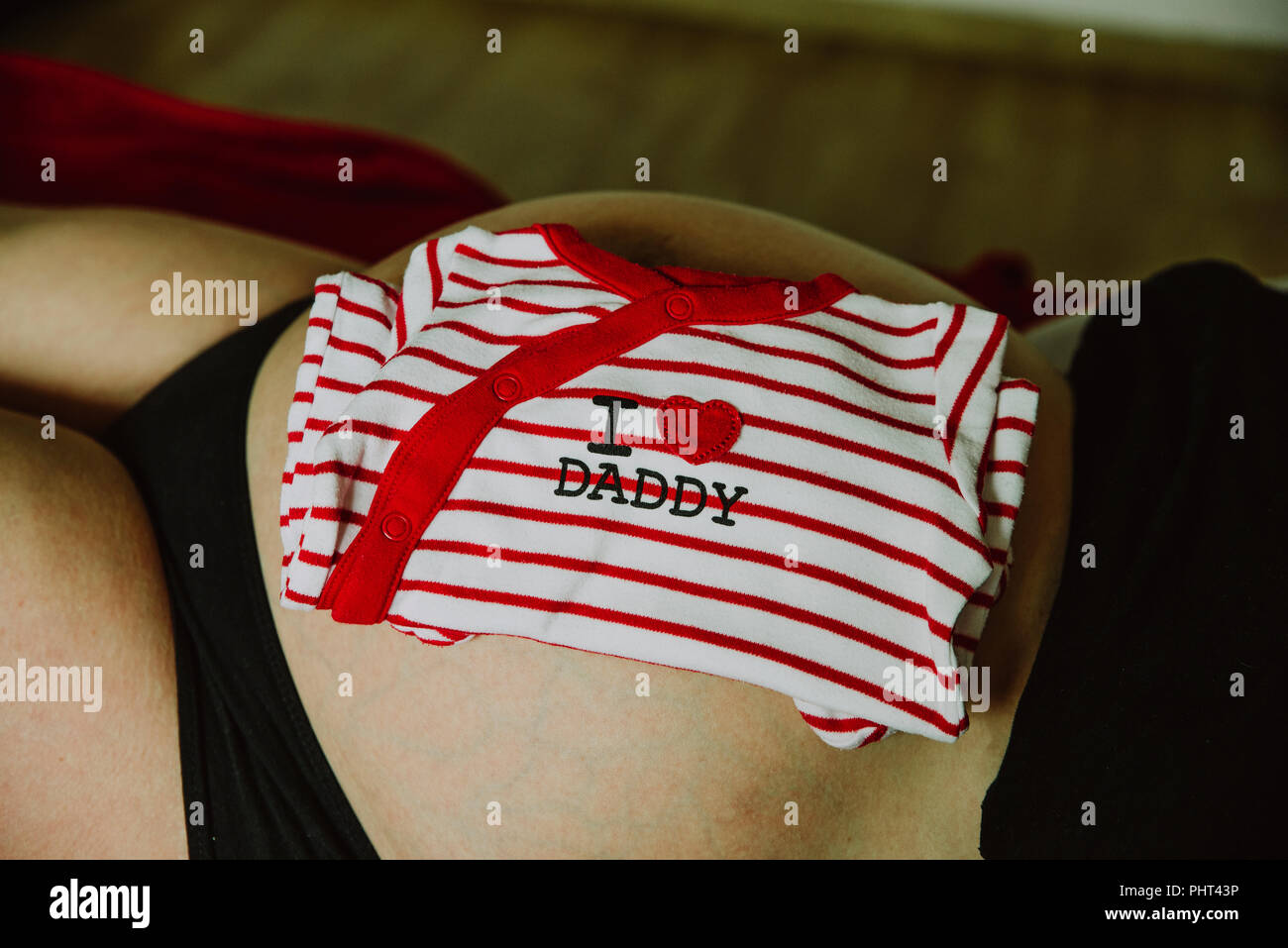 I love Daddy on rompers with a belly in the background - Stock Image