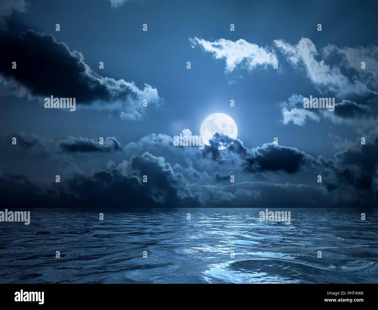 Full moon over the ocean - Stock Image