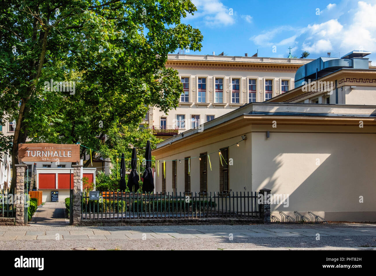 Berlin-Friedrichshain.Alte Turnhalle building exterior. Restaurant & lounge bar with large outside terrace. Listed old gymnasium,converted sports hall - Stock Image