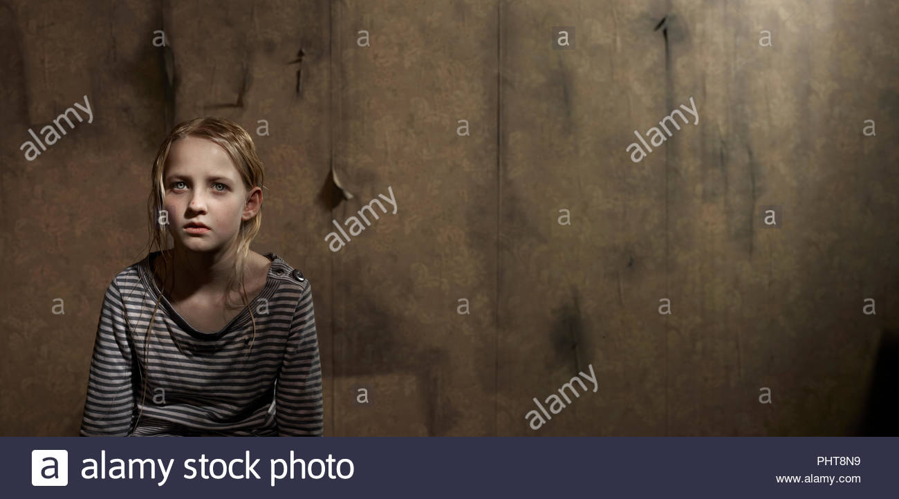 Girl in abandoned room Stock Photo