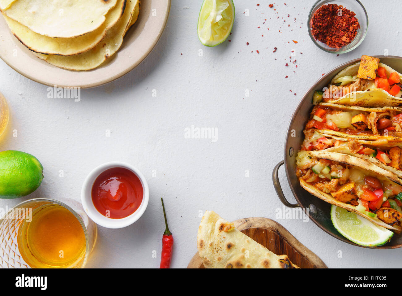 Overhead image of mexican tacos with chili con carne, sweet potatoes and grated cheese with text space - Stock Image