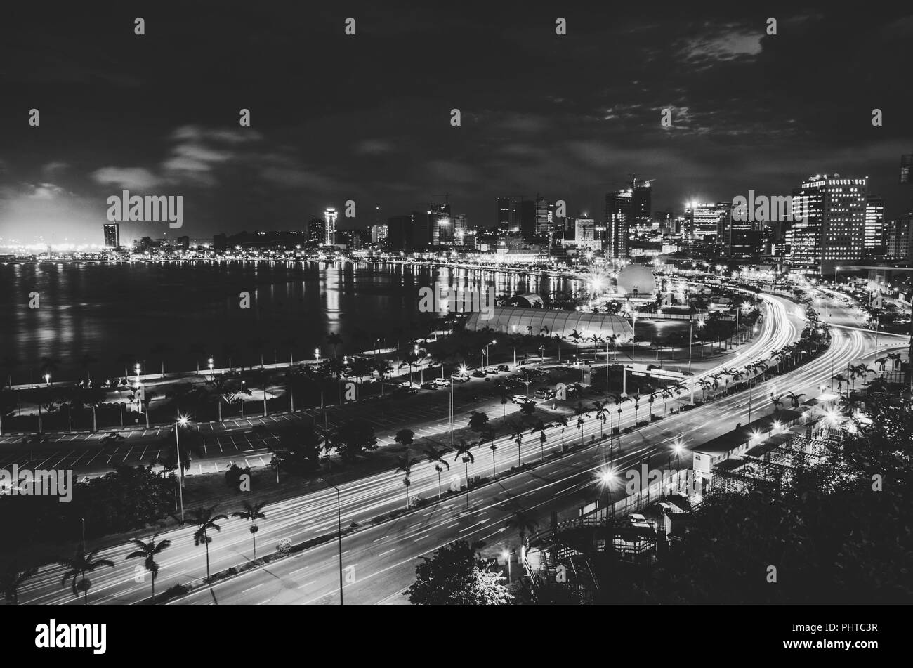 Skyline of capital city Luanda and its seaside during the night, Angola, Africa. - Stock Image