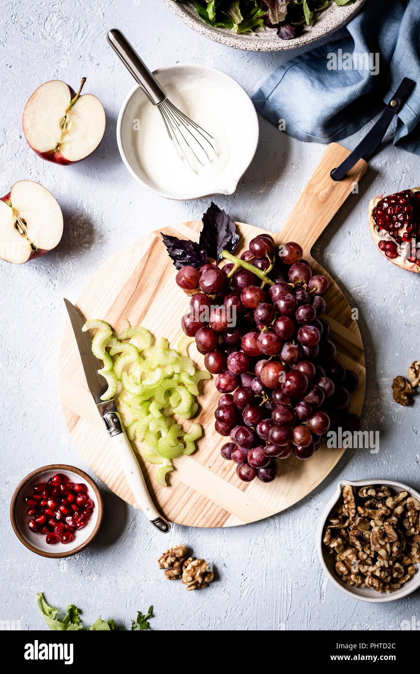 Grapes and celery being prepared as part of a salad - Stock Image