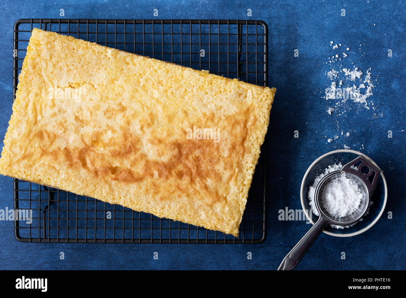 Homemade lemon slice with icing powder and sifter. - Stock Image