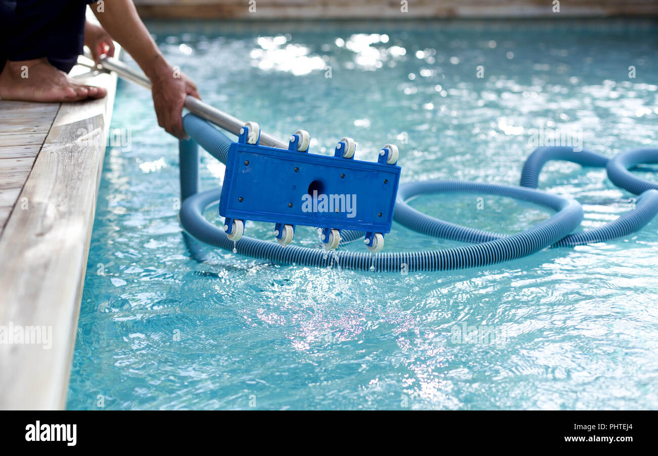 Man holding an equipment for cleaning swimming pool Stock Photo ...