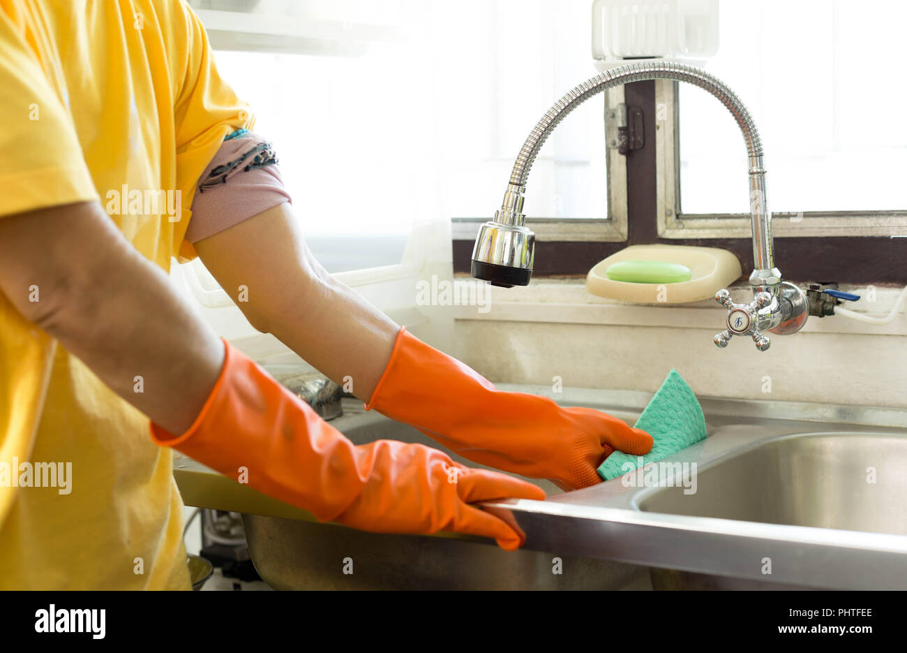 Hand With Orange Glove Cleaning Kitchen Sink Stock Photo Alamy