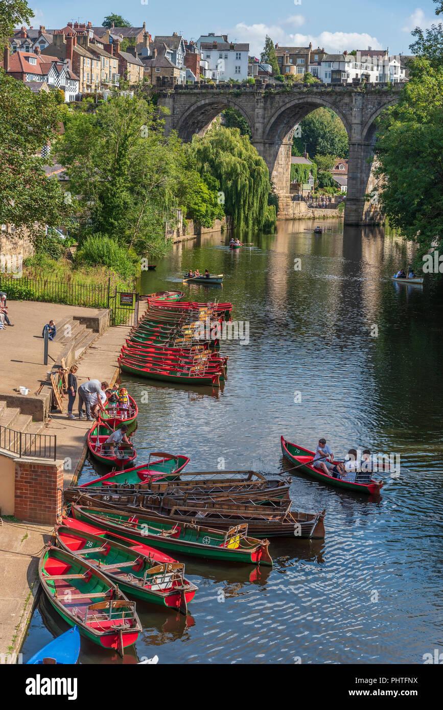Knaresborough. River Nidd and railway viaduct. Rowing boats. - Stock Image