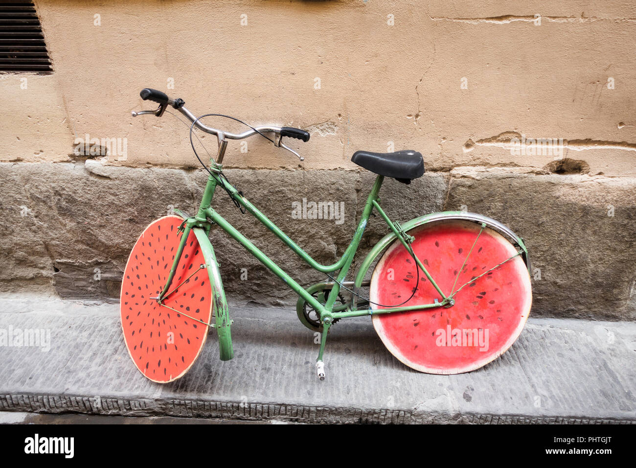 An artisticly painted bicycle in Florence, Italy. - Stock Image