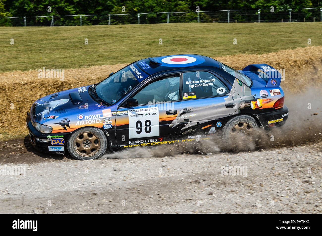 RAF Royal Air Force Subaru Impreza rally car racing on the special stage at the Goodwood Festival of Speed. Driven by Dan Megannity and Chris Daykin - Stock Image