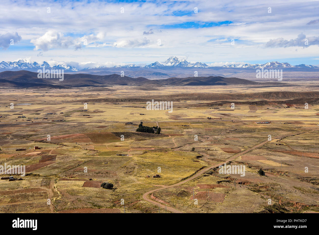 Panoramic view across the altiplano and the mountains of the Cordillera Real, near La Paz, Bolivia - Stock Image
