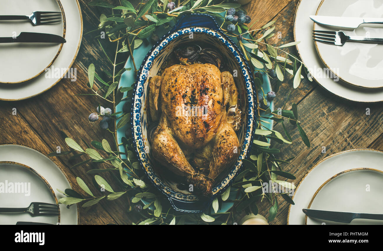 Flat-lay of whole roasted chicken in tray for Christmas celebration - Stock Image