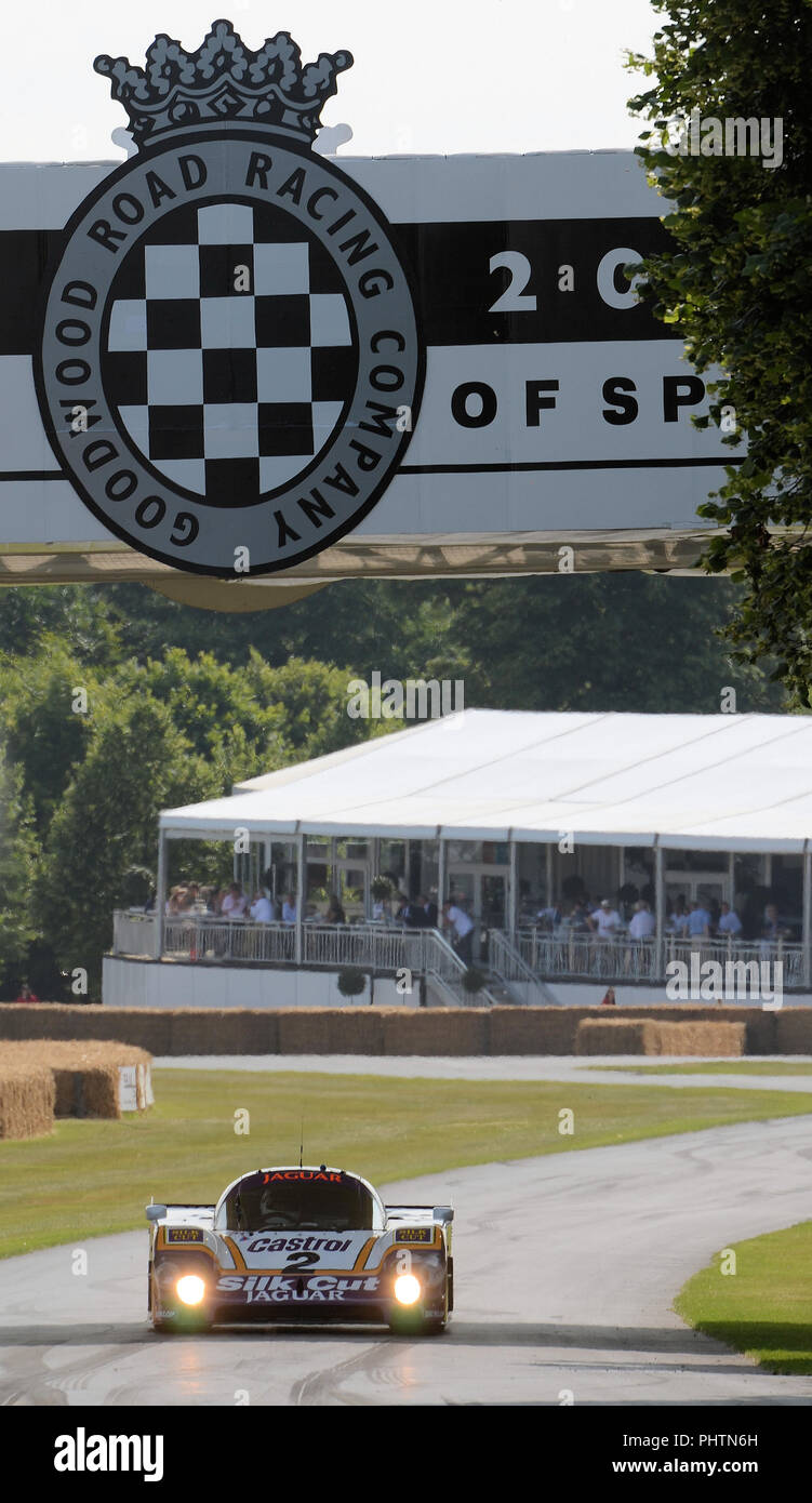 Le Mans Silk Cut Jaguar XJR-9 LM at Goodwood Festival Of Speed. Sports prototype racing car under Goodwood bridge. World Sports Prototype Championship - Stock Image