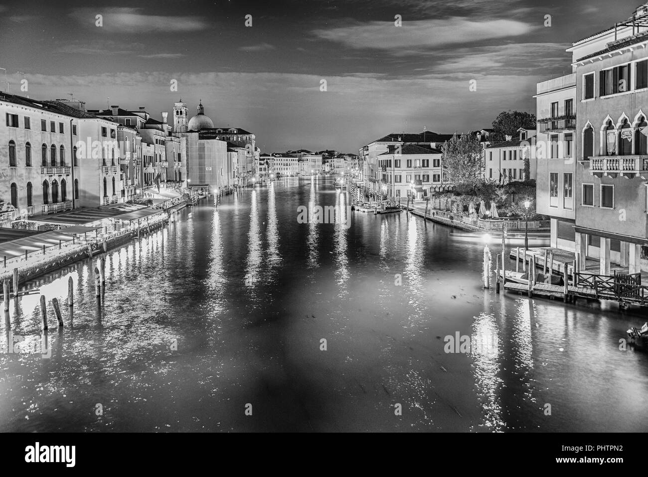 Scenic view at night with beautiful reflections of the Grand Canal in Venice, Italy - Stock Image