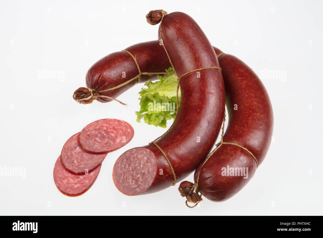 Sausage And Greenery - Stock Image