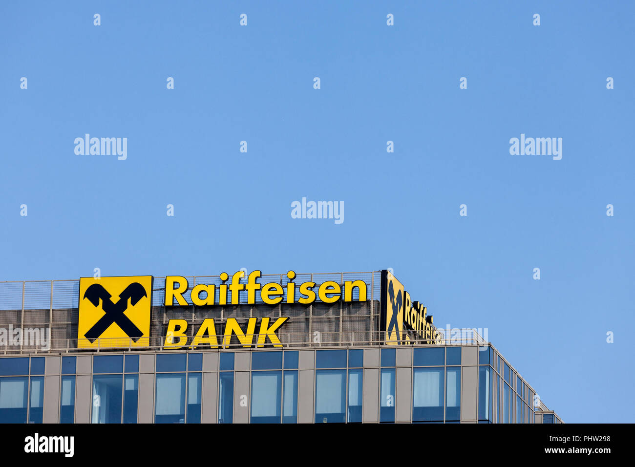 BELGRADE, SERBIA - SEPTEMBER 1, 2018: Raiffeisen logo on their main office for Serbia in Belgrade. Raiffeisen is an Austrian bank, massively investing - Stock Image