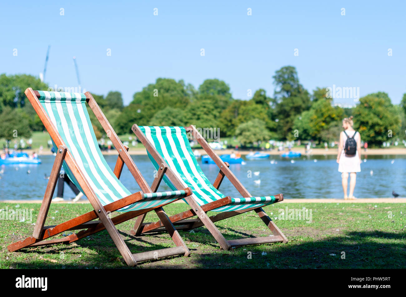 Deck chairs in the park in summertime - Stock Image