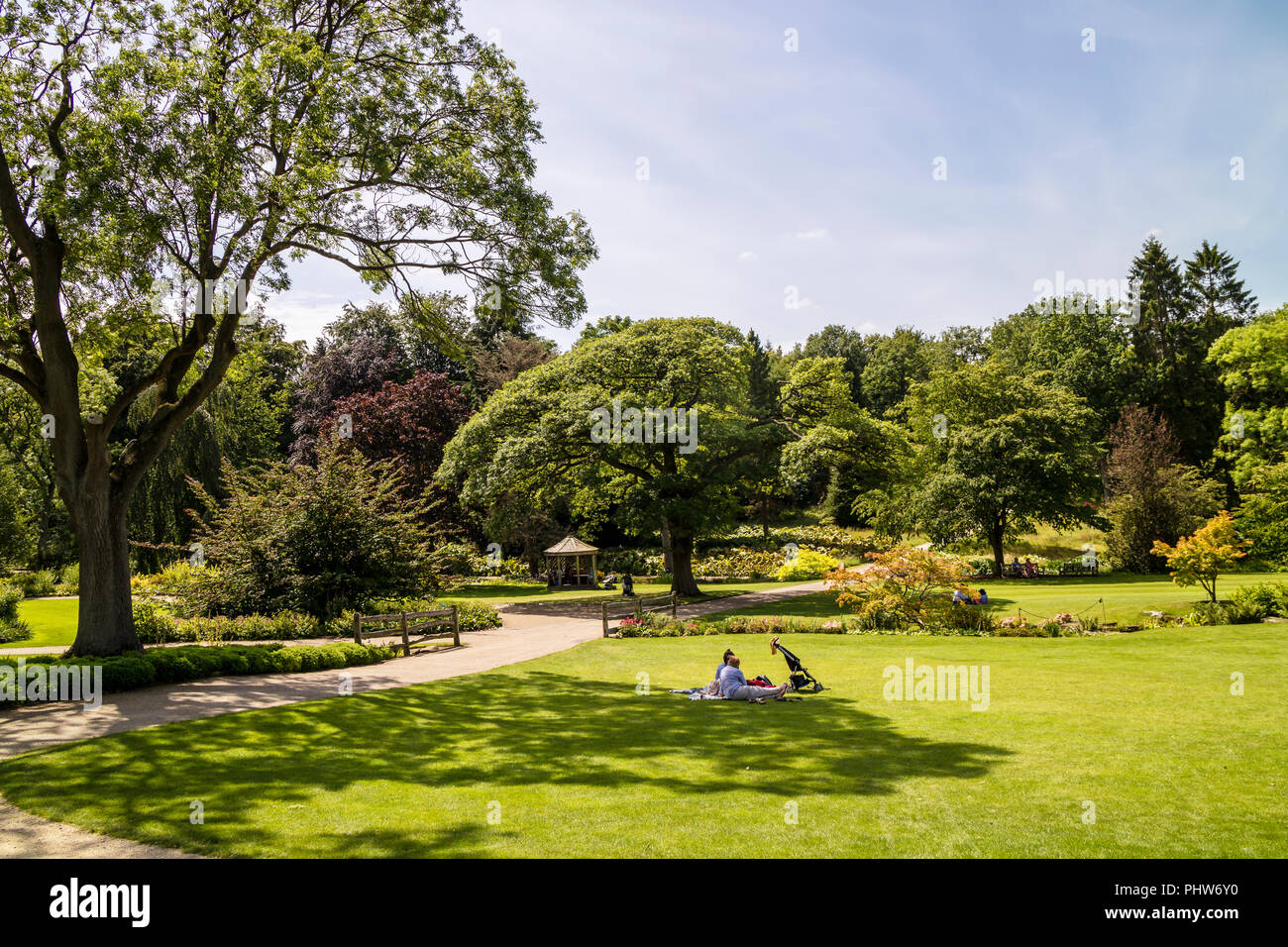 Large English style park with well kept green lawn suitable for picnics. - Stock Image