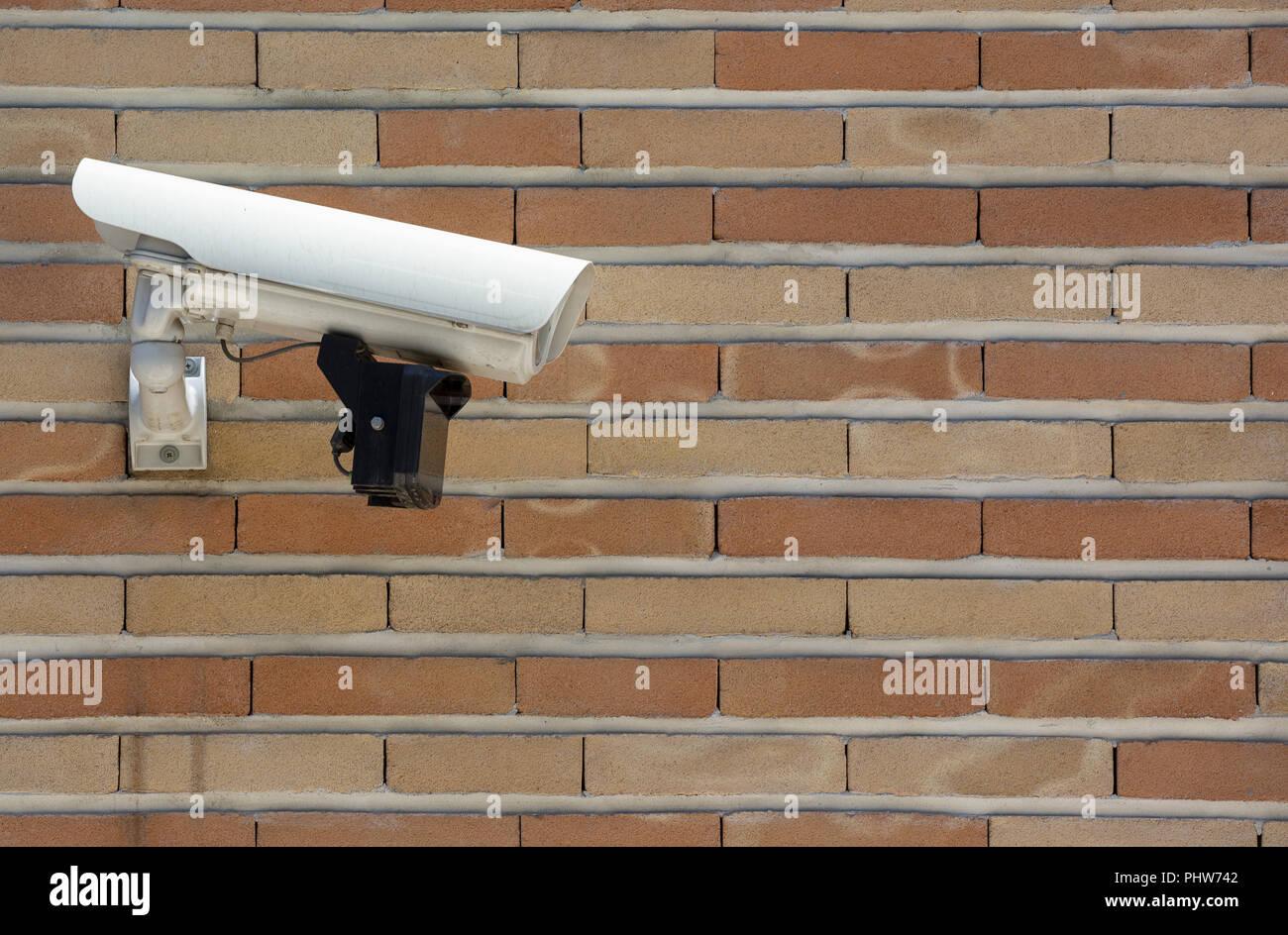 Surveillance camera brick wall - Stock Image