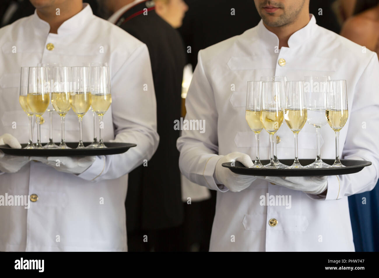 Waiters tray white wine - Stock Image