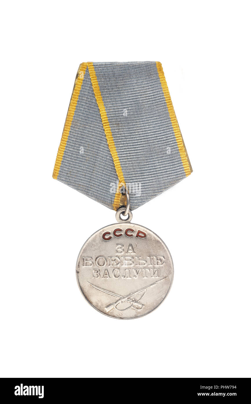 "Soviet medal. Translation of the inscription - «For combat services"". Isolate on white background Stock Photo"