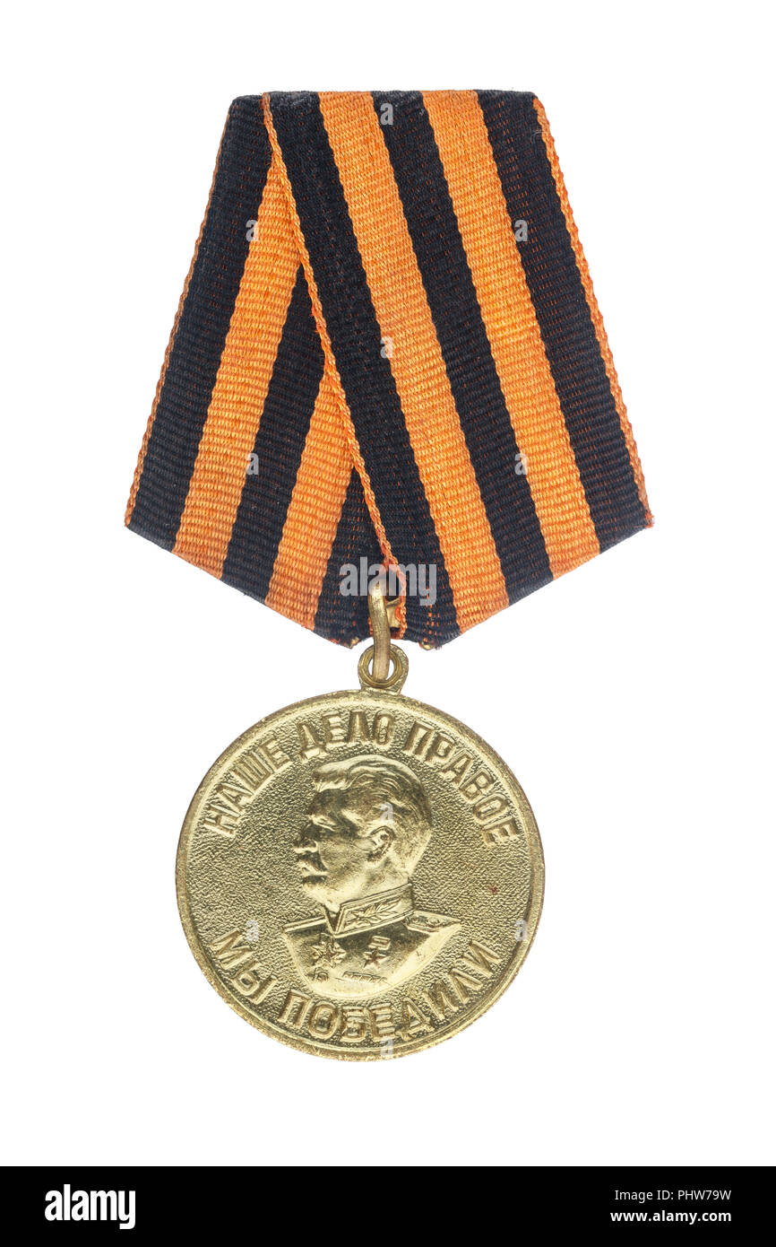 "Soviet medal. Translation of the  inscription - «Our deed is right, we won"". Isolate on white background Stock Photo"