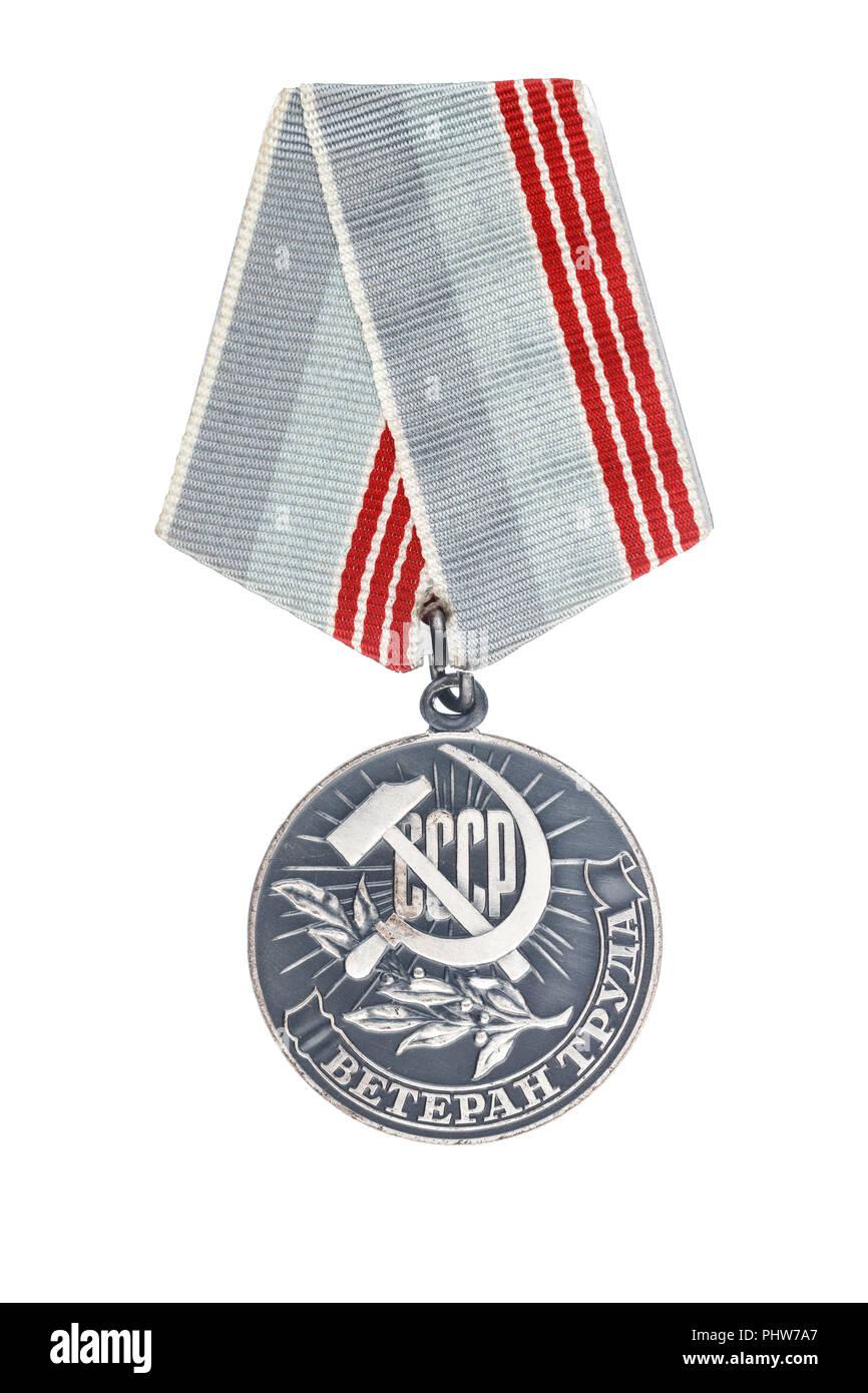 "Soviet medal. Translation of the inscription - «Veteran of labour"". Isolate on white background Stock Photo"