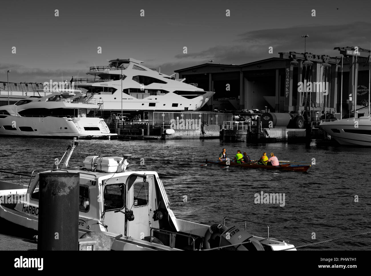 Poole, Dorset, England. A training session for a Coxed 4 in Guinevere run past the Sunseeker factory in Poole Dorset, England - Stock Image
