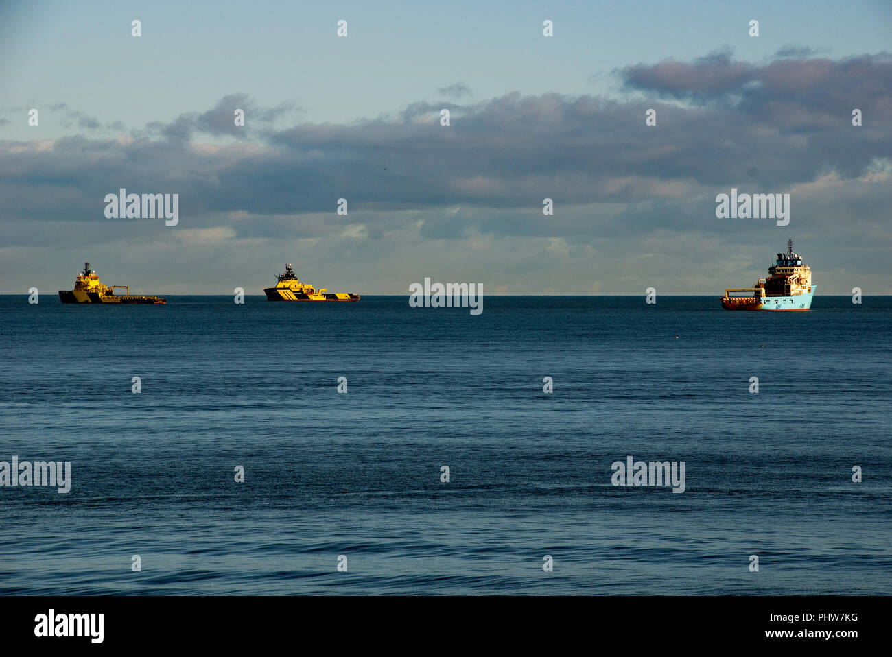 Oil rig support vessels at anchor in the North Sea off the North beech of Aberdeen Scotland - Stock Image