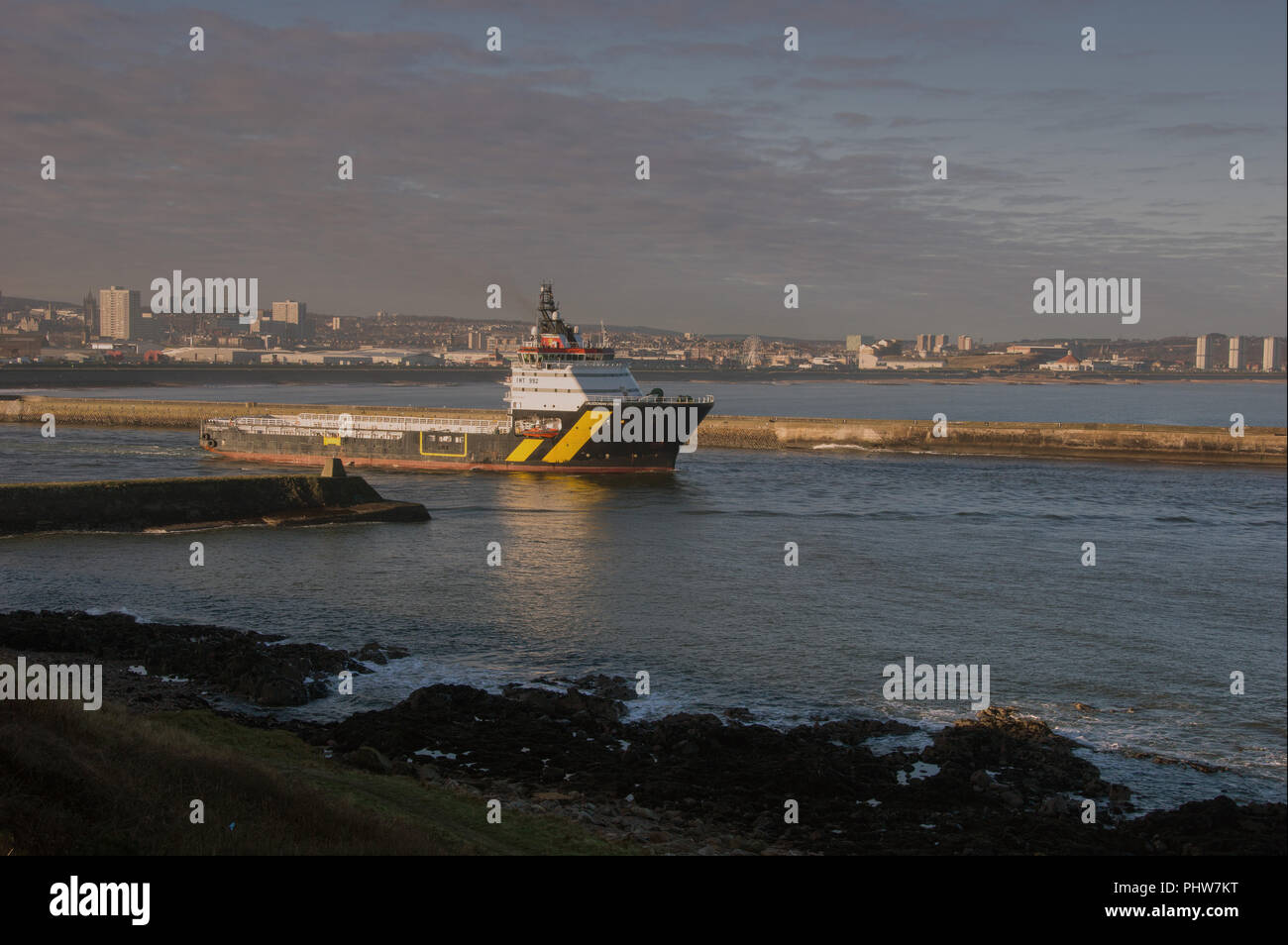 Oil Rig Support vessel (OSV). Caledonian Vision leaving Aberdeen harbour for operations in the North Sea - Stock Image