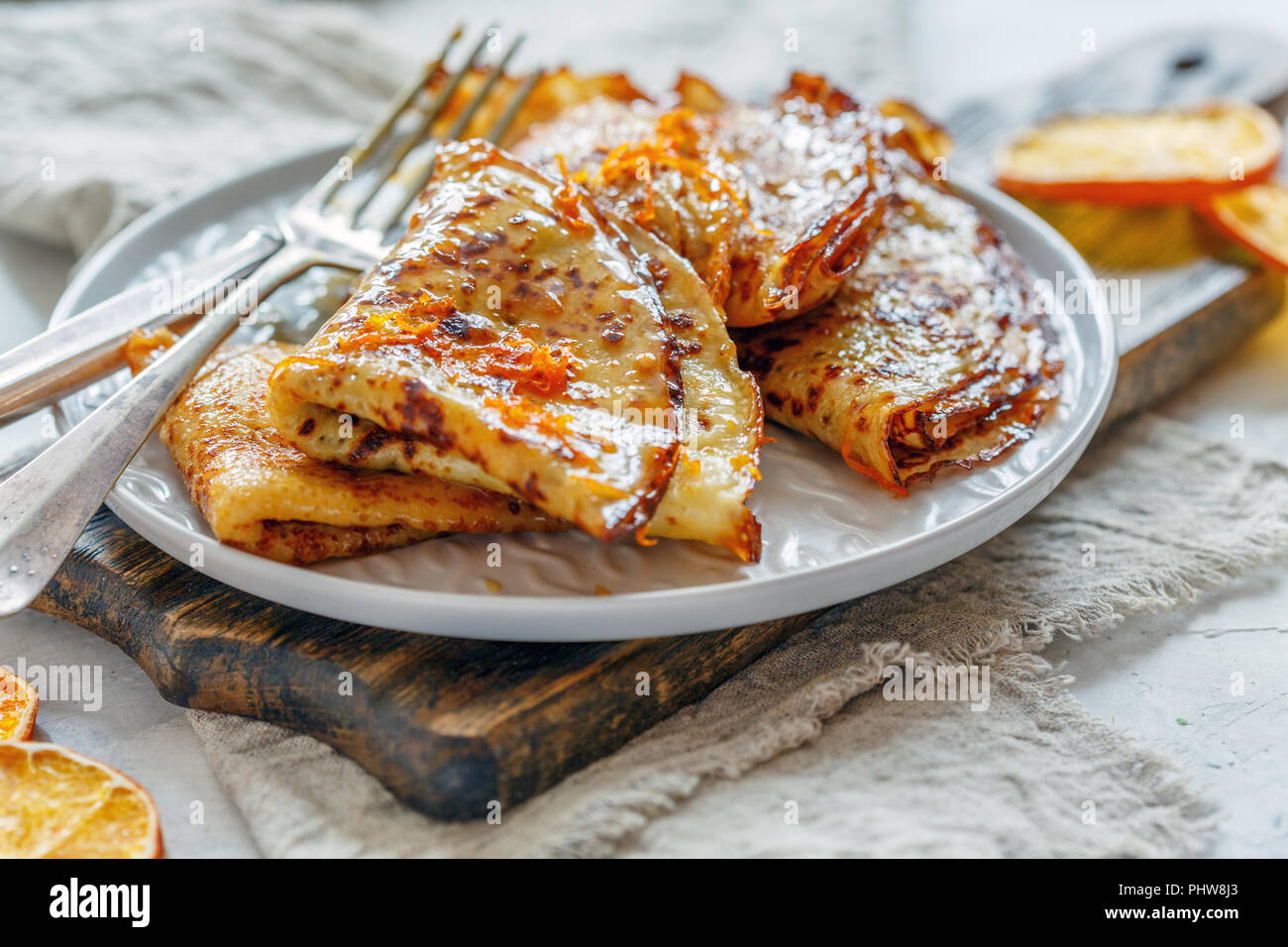 Thin crepes with orange sauce. - Stock Image