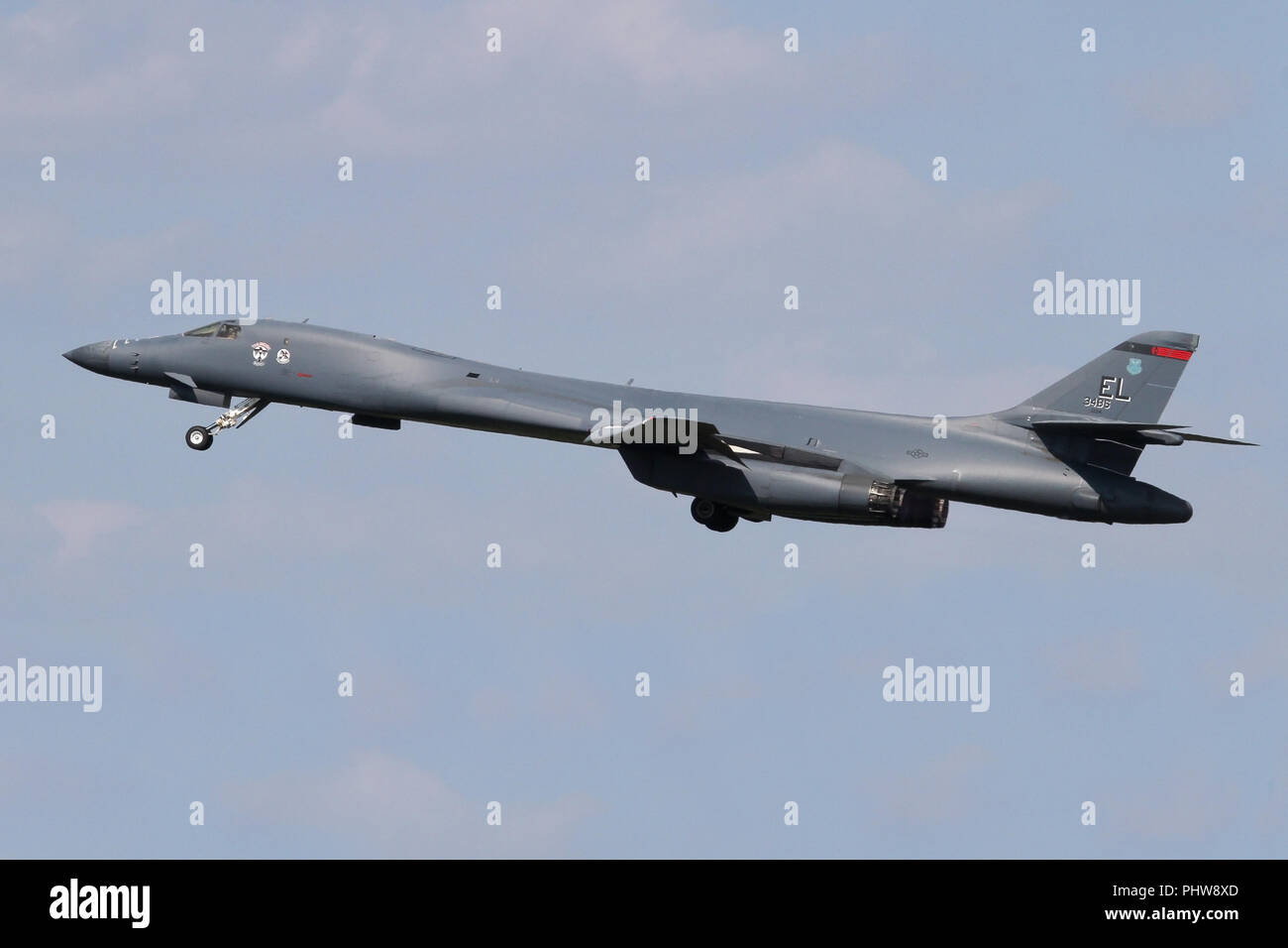 Rockwell B-1B Lancer from the 34th Bomb Squadron at Ellsworth AFB, South Dakota climbing out of RAF Mildenhall, Suffolk after a brief fuel stop. - Stock Image