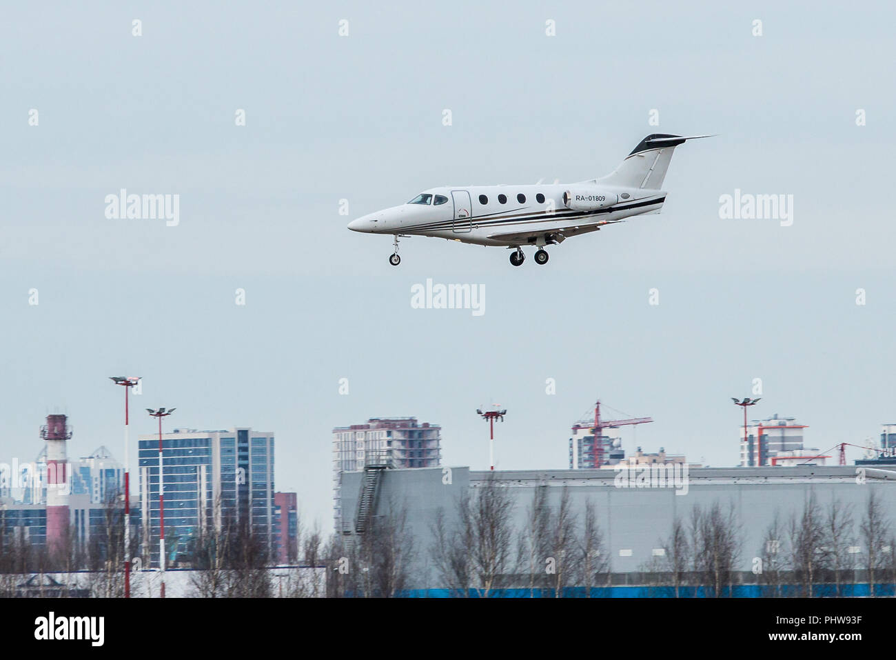 SAINT PETERSBURG, RUSSIA - APRIL 09, 2017: Flying the privately owned Raytheon 390 Premier (OM-VPB) - Stock Image