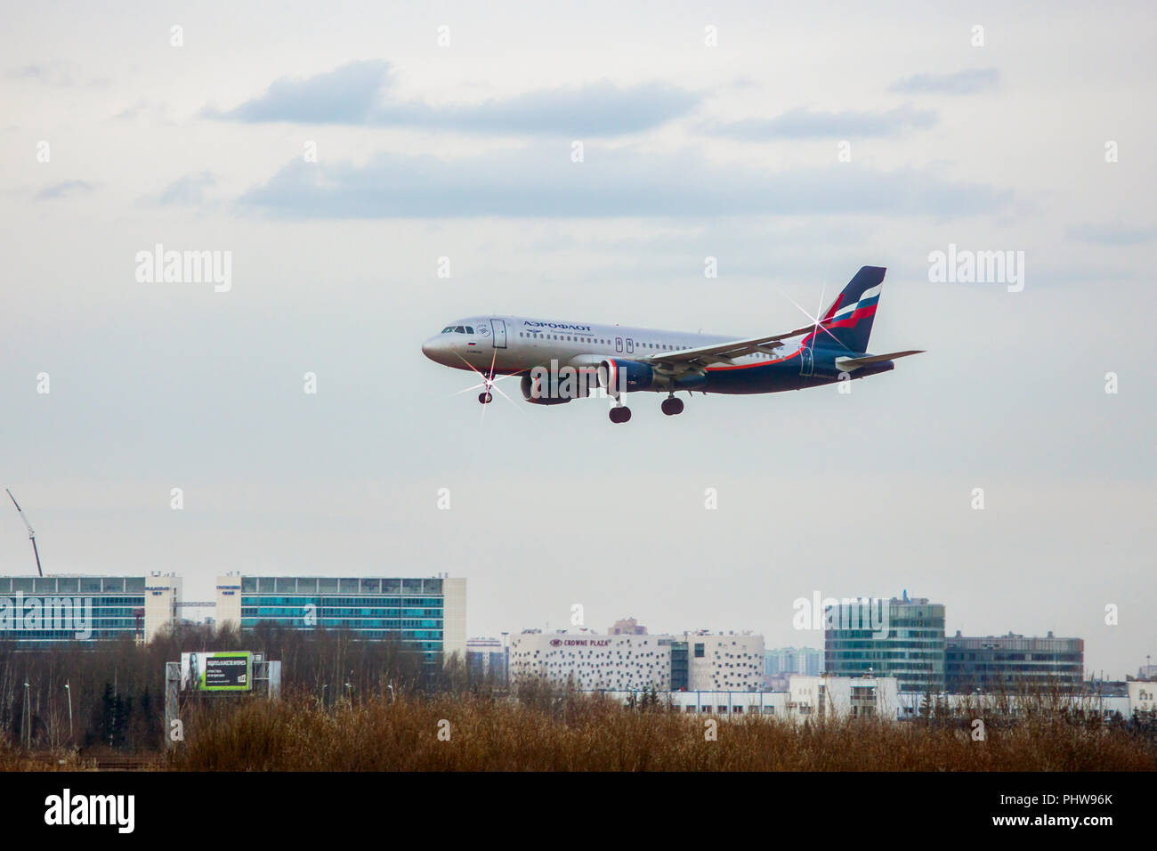 SAINT PETERSBURG, RUSSIA - APRIL 09, 2017: Flying the Airbus A320-214(WL) (VQ-BSI) airline «Aeroflot». Aircraft name «V. Komarov». The plane goes on l - Stock Image