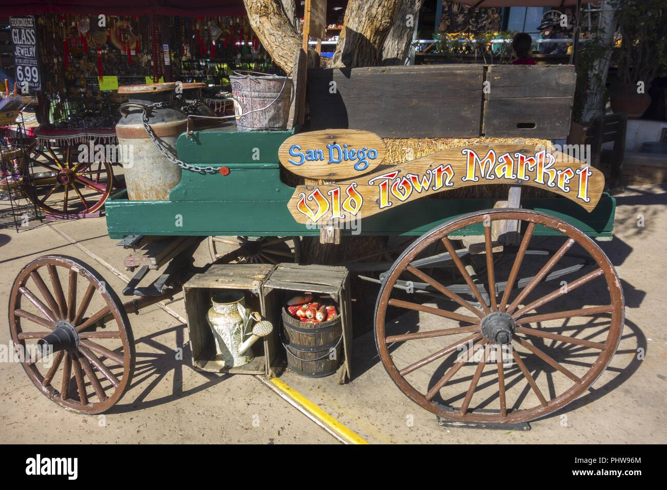 Vintage Rustic Wagon Wheel at Market Entrance to Historic Old Town State Park in San Diego California - Stock Image