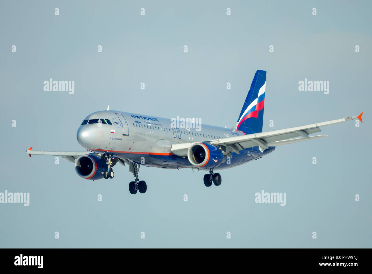 SAINT PETERSBURG, RUSSIA - APRIL 19, 2017: Flying the Airbus A320-214 (VP-BZR) airline «Aeroflot - Russian Airlines». Aircraft name «F. Bellinsgauzen» - Stock Image
