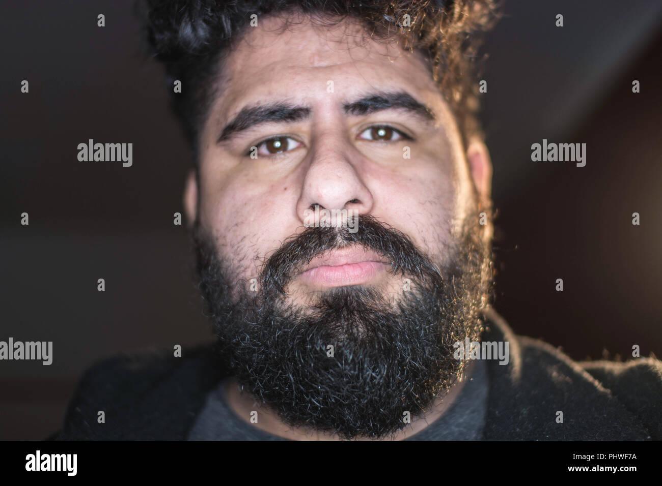 Portrait of hispanic man looking at the camera - Stock Image
