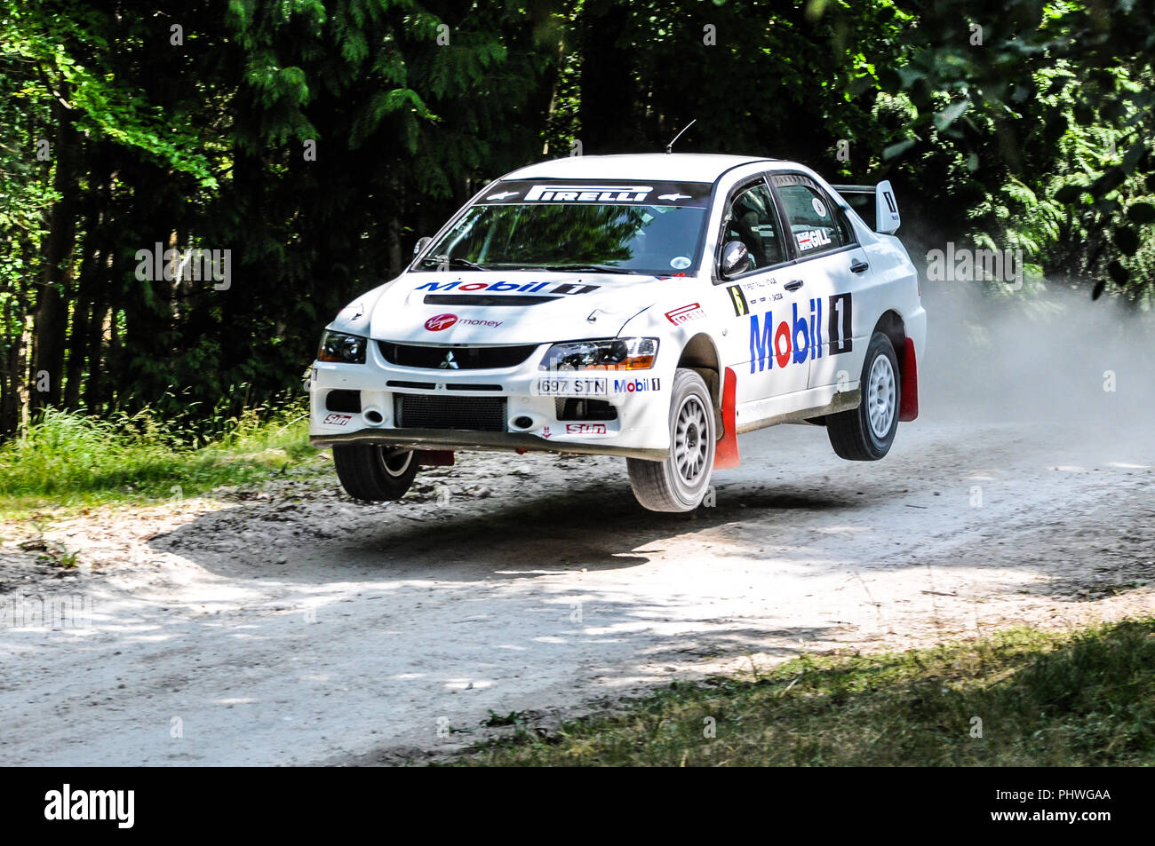 Mitsubishi Lancer EVO IX rally car racing on the special forest stage at the Goodwood Festival of Speed. Jumping. Airborne. Flying. Rob Gill - Stock Image