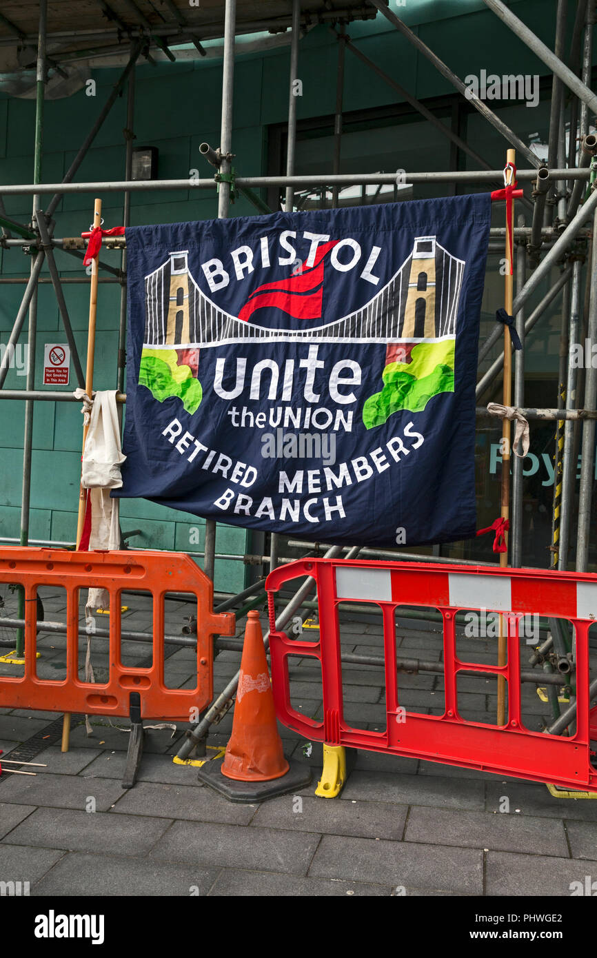 The Bristol branch of the trade union Unite's retired members branch banner on display at a demonstration in Bristol, UK - Stock Image