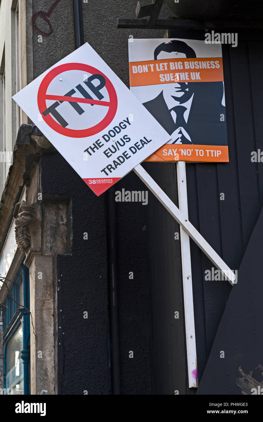Placards protesting against TTIP mounted on a wall on Turbo Island, Stokes Croft, Bristol, UK - Stock Image
