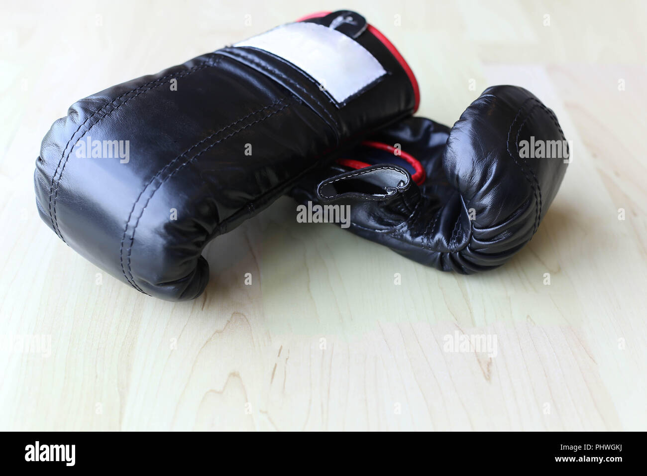 Pair of black leather boxing gloves - Stock Image