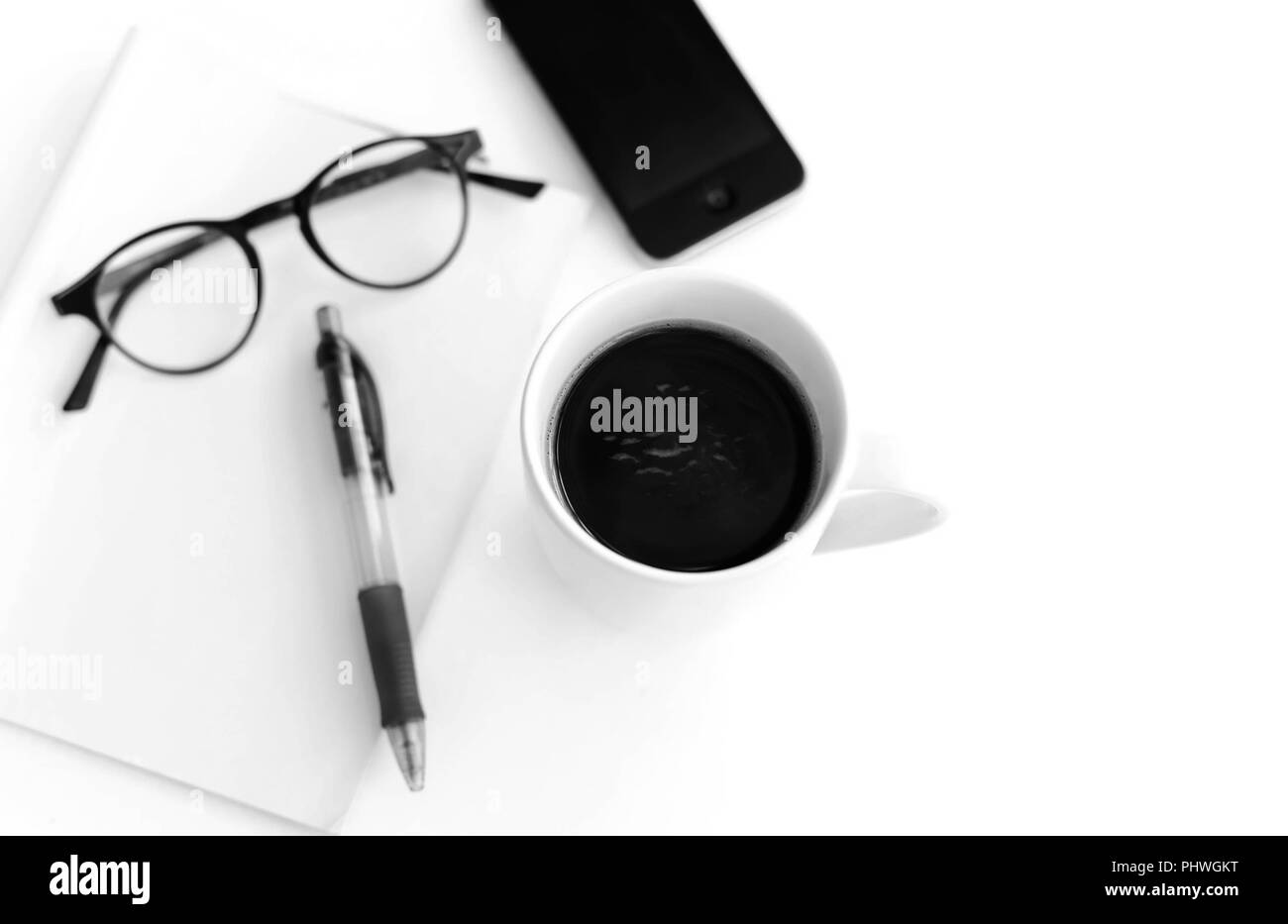 Coffee with blank paper note and glasses - Stock Image