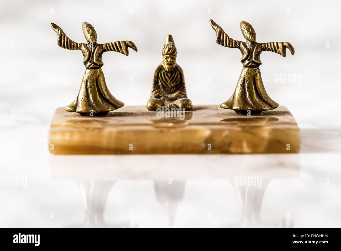 Whirling dervish bronze figurines with marble pedestal - Stock Image