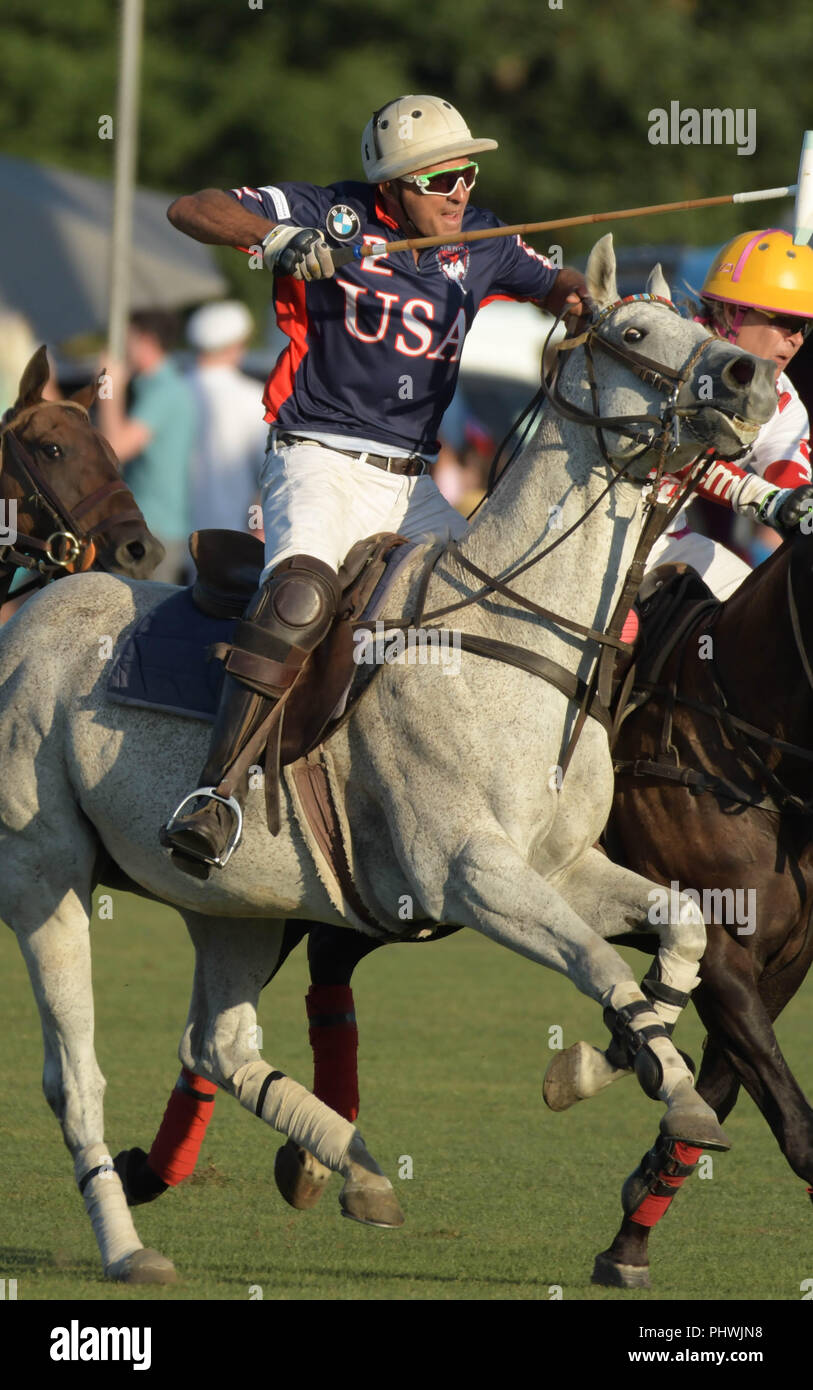 Player Michel Nseir chases the ball during the annual England vs. USA polo match in Newport, R.I., USA. - Stock Image