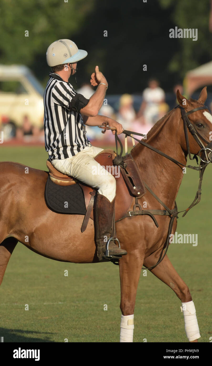 A polo referee gives a thumbs up signal during the annual England vs. USA match in Newport, R.I., USA. - Stock Image