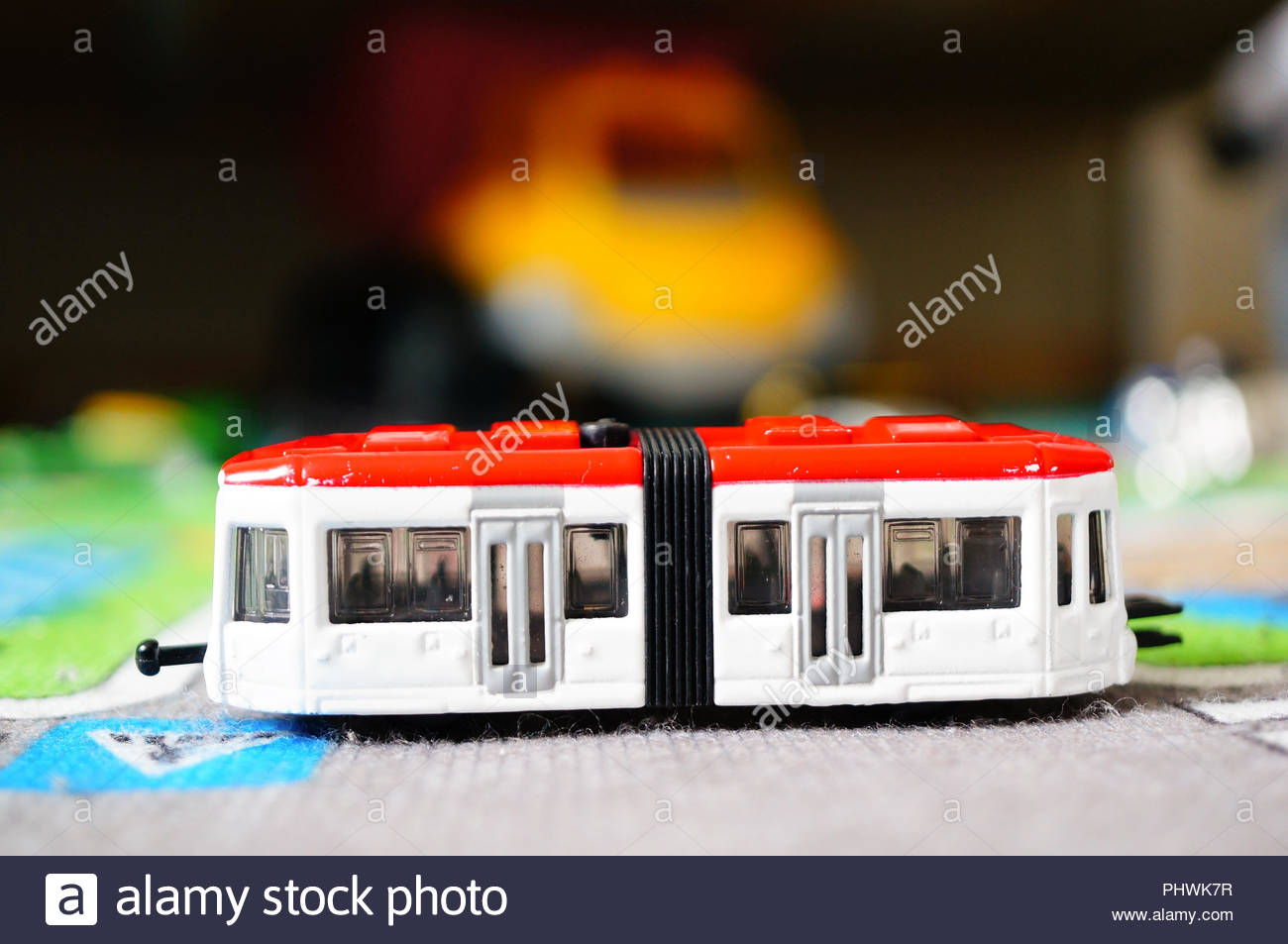 Siku metal toy tram on a street mat in soft focus Stock Photo