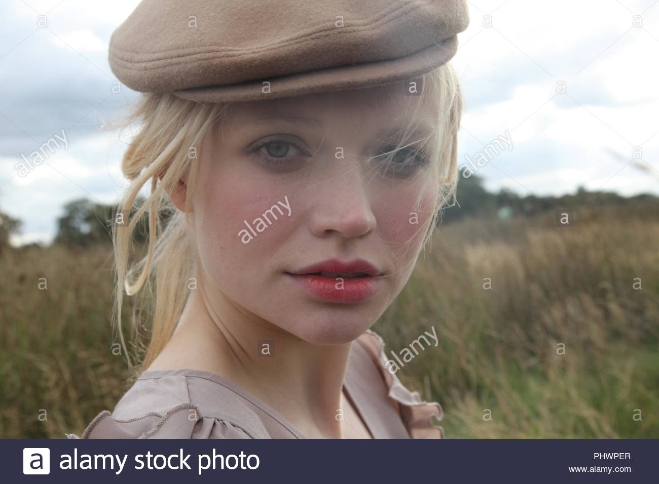 58c2ce8146f0f Young woman wearing hat Stock Photo  217540031 - Alamy