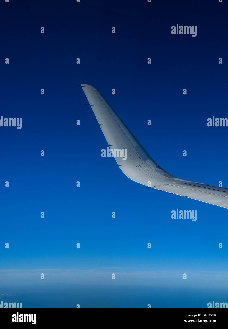"Curved wingtip, known as a ""winglet"", of a modern passenger jet. The winglet design improve an aircraft's fuel efficiency. - Stock Image"