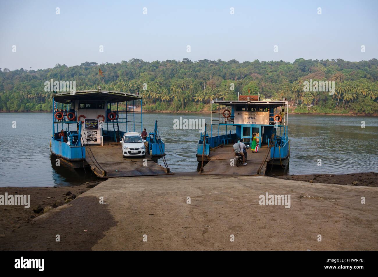 The Volvoi - Surla and Volvoi - Maina FerryBoats waiting side by side at Volvoi Ferry Terminal, Savoi-Verem, Goa, India - Stock Image