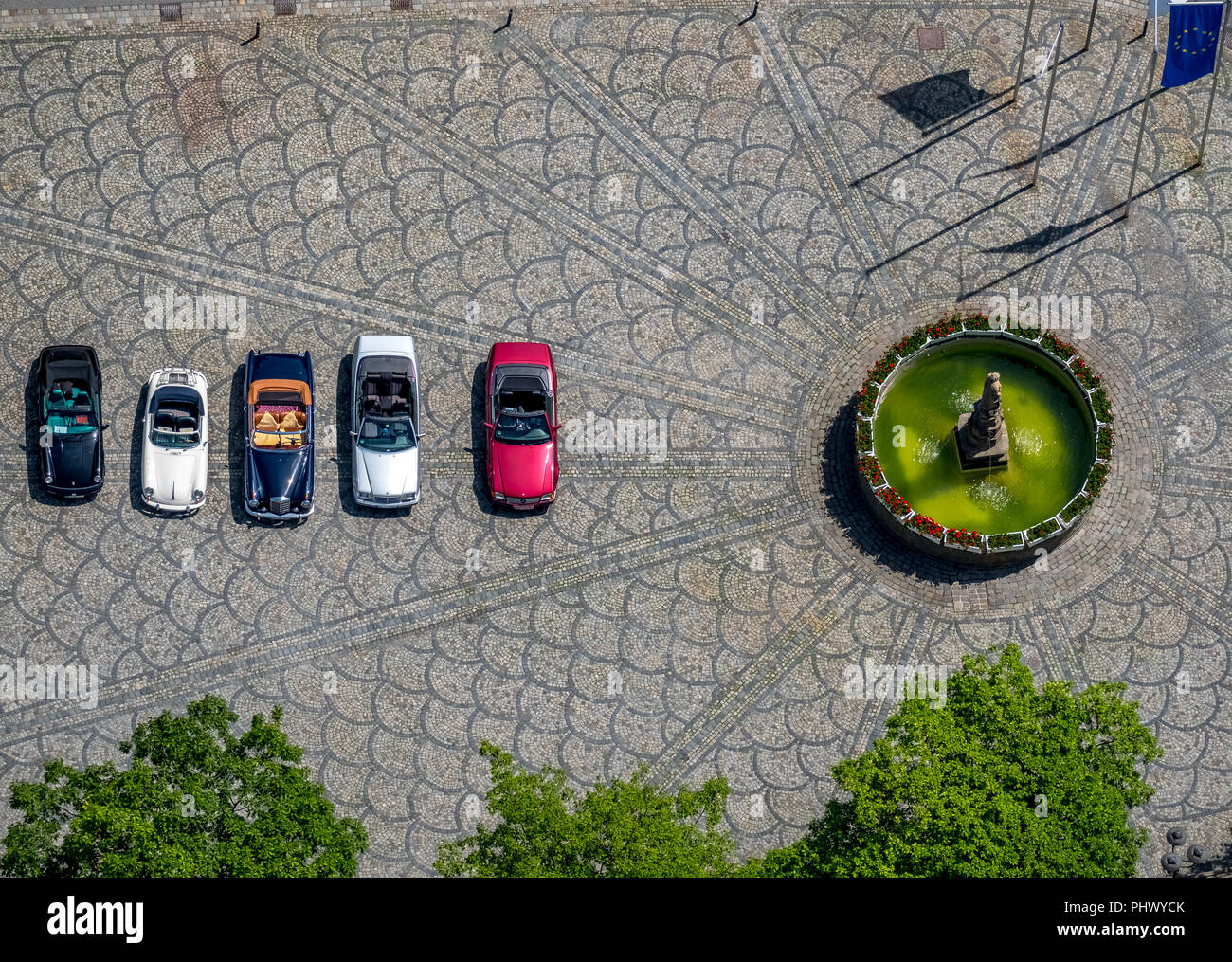 historic pictures of four vintage convertibles at Petrusbrunnen, Autoralley, vintage Porsche and Mercedes convertible, Kump, Brilon, Sauerland, North  - Stock Image